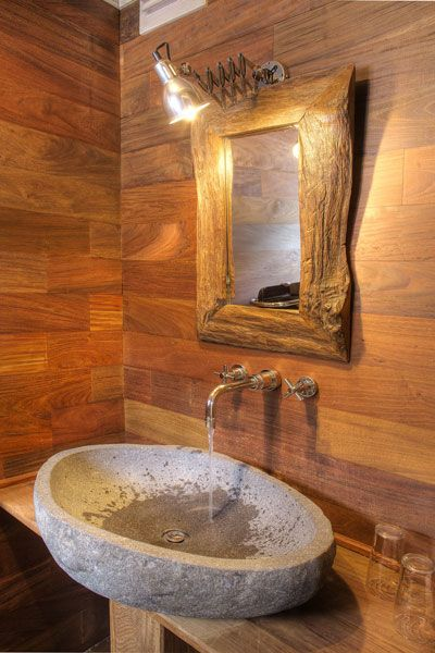 Love the natural stone sink, with the masculine wood. Note how the sink overhangs the stand.