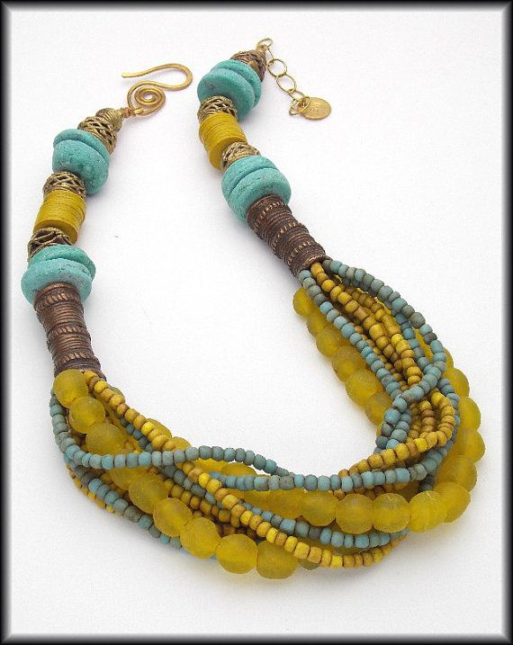 This necklace is RESERVED for Debbie. 1 of a Kind! AWESOME necklace....colors are incredible....my absolute favorite chartreuse (somewhere between green and yellow....and totally divine!) accented by light shade of turquoise. The two colors together are spectacular! Eleven strands of handmade African recycled glass beads made by Krobo People using centuries old methods and handmade, tiny Indonesian glass beads are woven thru old, handcast brass African hair beads. These beads were cast with…
