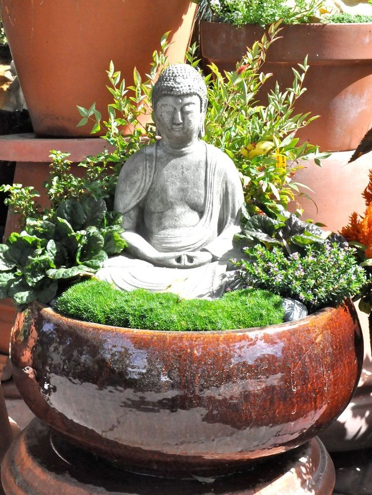 zen container... don't really like religious statues, but maybe replace it with something...