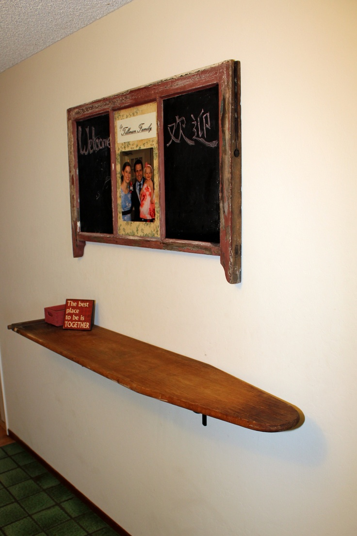 Shelf is an old wooden ironing board; upcycle, recycle, salvage, diy, repurpose! For ideas and goods shop at Estate ReSale & ReDesign, Bonita Springs, FL