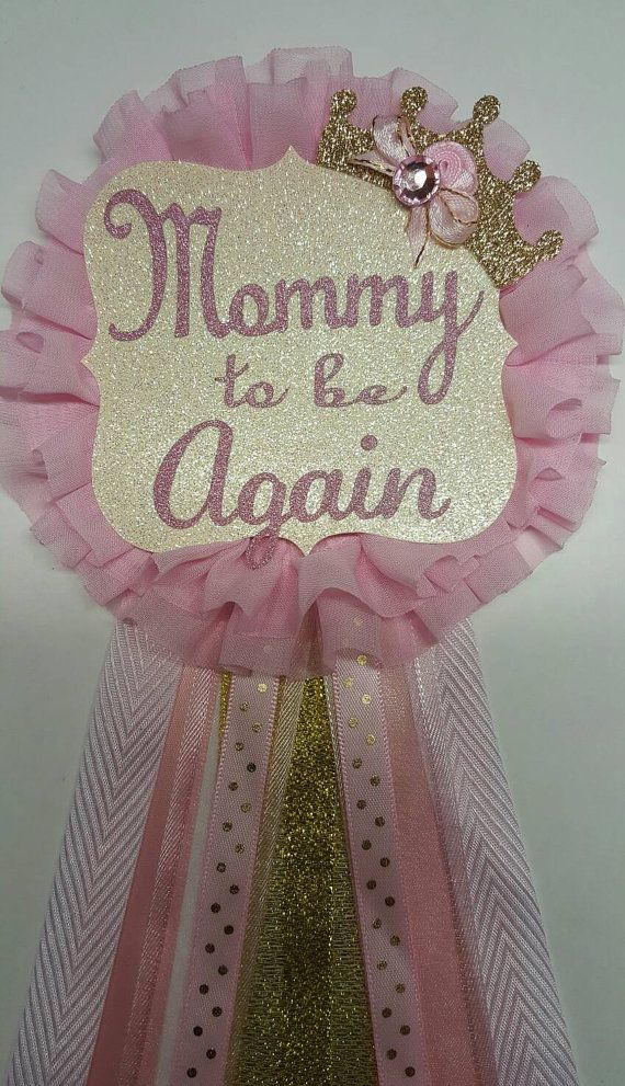 Elegant mommy to be corsage for your pink and gold princess royal baby shower theme. Shimmery gold tiara a shimmery mommy to be tag on a