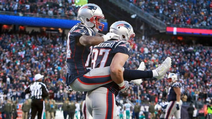 After he scored on a fourth quarter five-yard touchdown pass, Brandin Cooks jumped on the back of teammate Rob Gronkowski.