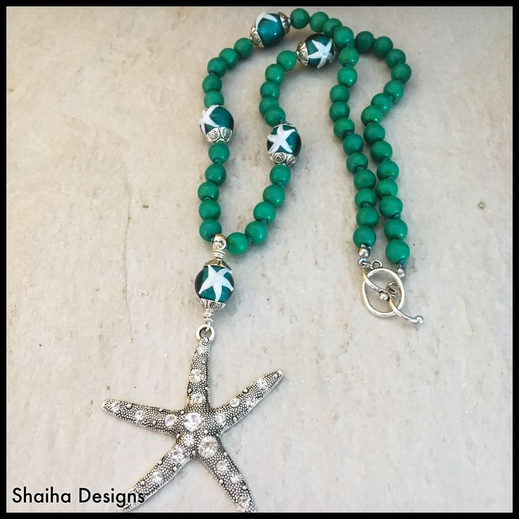 "It's time to go play in the warm tropical seas. Or at least, bring the tropics to you. This sassy necklace has all warmth of the water complete with some starfish to keep you company.     This hand knotted turquoise howlite necklace is 21"" long with the starfish focal adding another 3 1/2""."