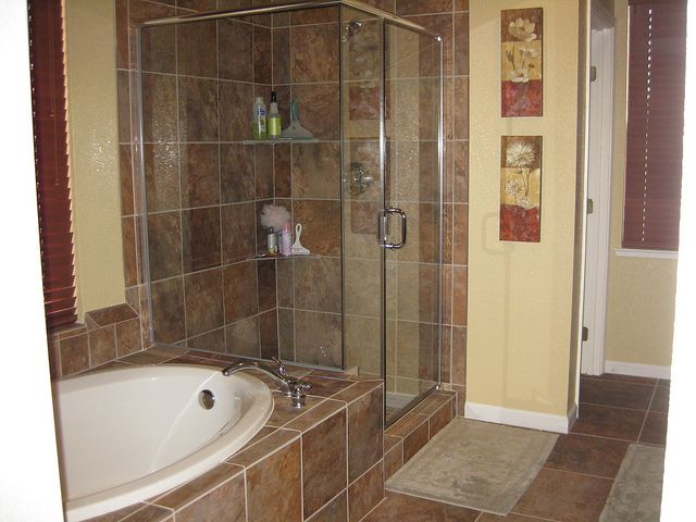 Bathroom remodeling idea darker tile with warm earth tone for Earth tone bathroom ideas