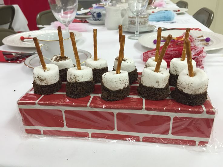 Chimney Sweep treats for our Mary Poppins party- pretzel sticks, marshmallows, chocolate dipped and rolled in crushed chocolate graham crackers