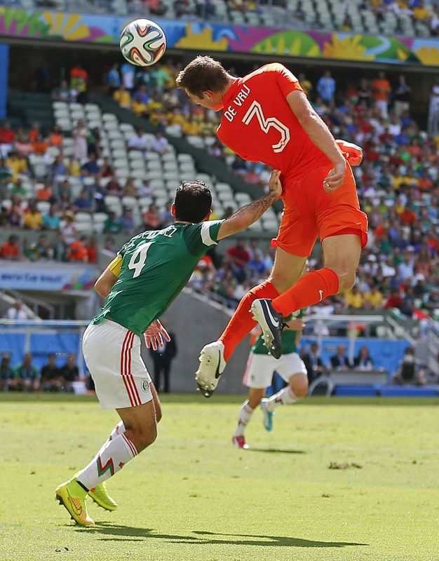 Mexico's Rafael Marquez pushes off Netherlands' Stefan de Vrij as he heads the ball during the World Cup round of 16 soccer match between th...