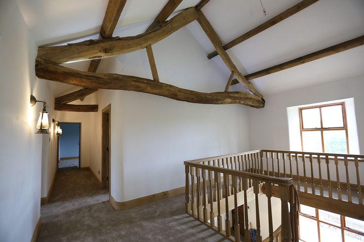 exposed roof trusses, upstairs of old farm house