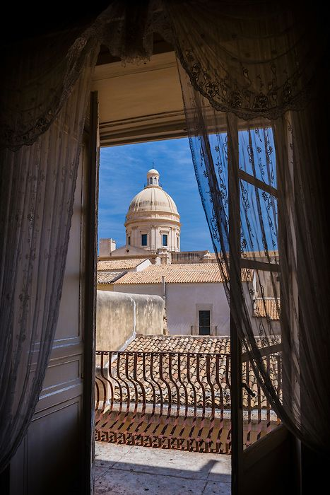 Dome of Noto Cathedral seen from Palazzo Nicolaci di Villadorata - Noto, Sicily, Italy Beautiful Palazzo, loved the views of the city from the balconies...