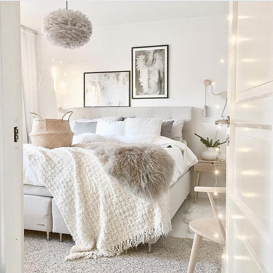 clean white bedroom with neutral accents using lots of texture such as rugs faux fur. beautiful ideas. Home Design Ideas