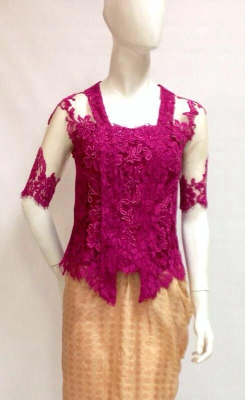 A beautifully crafted kebaya to attend weddings. Its bright color will certainly get you noticed. Wear the top with your favorite kain and matching clutch.  For pricing, sizing, and ordering details please email us at nmayinda@gmail.com, Whatsapp us at 081299331039, or BB us at 2B07B968. We ship worldwide.