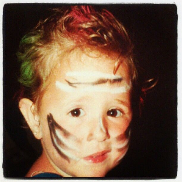 A long time ago...  Punk make up. Funny baby. Carnival.