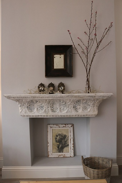 Salvaged tin shelf as mantle. by Donna Aragi.  www.cugogran.com