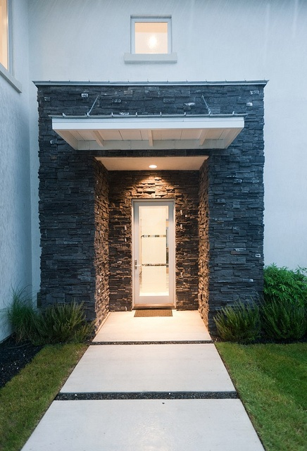 modlin modern front entry | photo by jeremy enlow | 360 west magazine august 2012 | stacked stone | glass front door | modern entry | concrete pavers