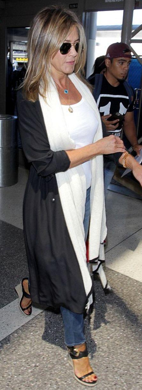 Who made  Jennifer Aniston's aviator sunglasses, gold jewelry, wedge sandals, and black handbag?