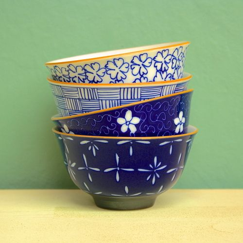 Fair Trade Mai Rice Bowls — handmade in Vietnam — find them at Fair & Square Imports — This set of 4 hand-painted ceramic rice bowls each features a different floral or graphic pattern. Microwave safe.