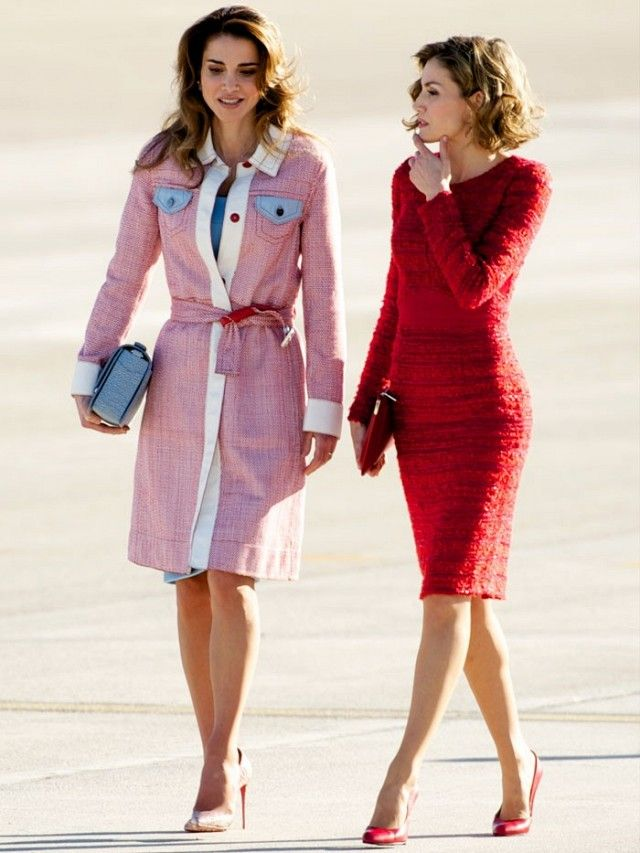Queen Rania of Jordan wears a belted pink coat with a blue dress and nude heels. Queen Letizia of Spain wears a red dress with red pumps.