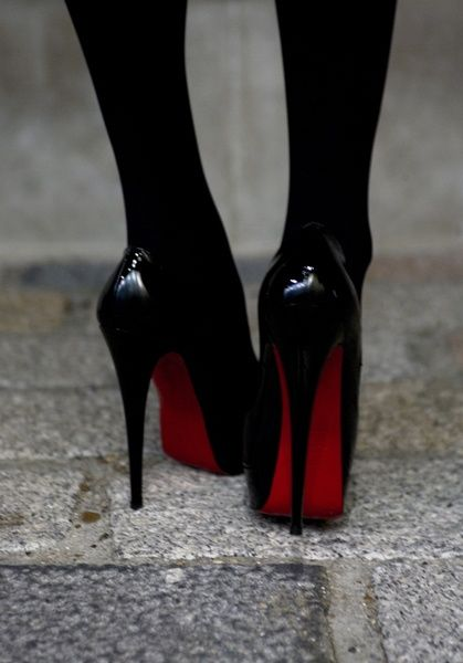 I've wanted these sexy black louboutins forever. I love love love the red underneath.