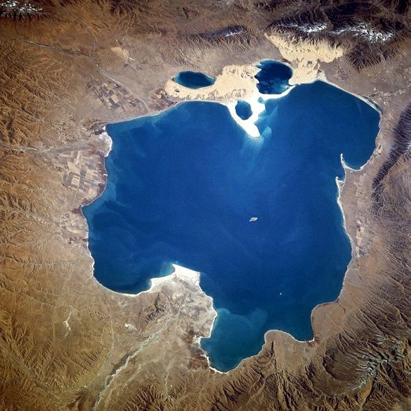 """Qinghai Lake (青海湖, qīnghǎi hú) is another tourist attraction, albeit further from Xining than Kumbum. The lake is the largest saltwater lake in China, and is also located on the """"Roof of the World,"""" the Tibetan Plateau. The lake itself lies at 3,600m elevation. The surrounding area is made up of rolling grasslands and populated by ethnic Tibetans. Most pre-arranged tours stop at Bird Island (鸟岛, niǎo dǎo). An international bicycle race takes place annually from Xining to Qinghai Lake."""