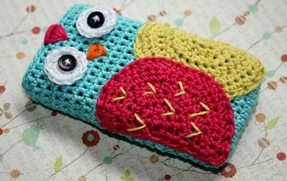 Crocheted owl cell phone case.