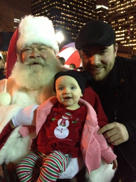 Our guy - Chris Young - with his niece and her first photo with Santa!