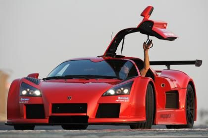 Awkwardly named and awkward to look at, the Gumpert Apollo makes up for any perceived lack of finesse with brutish pace. The Sport version set a 7:11.57 lap in 2009 powered by a 710bhp a twin-turbo V8 engine.
