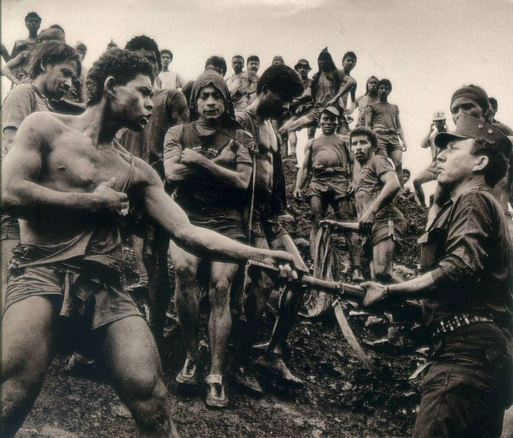 Sebastião Salgado: Dispute between Serra Pelada gold mine workers and military police, Brazil, 1986