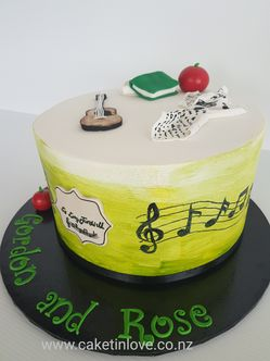 "A 10"" chocolate cake filled with chocolate ganache, covered in lime pettinice fondant. Fondant guitar, books etc. #chocolatecake  #pettinice    ​#cakesnorthland   #caketinlove"