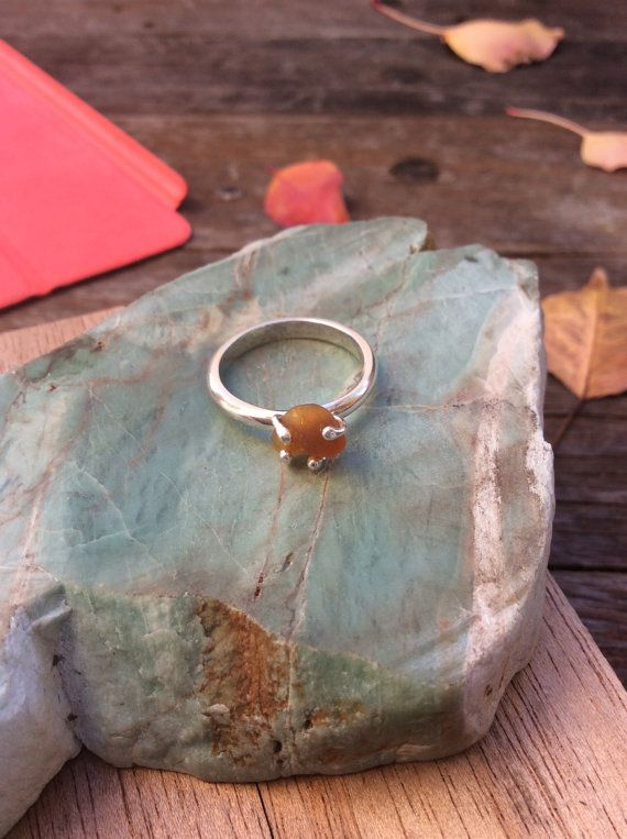 The band is 100% sterling silver, with a half round profile, 2.5mm wide, and the frosted amber sea glass gem is an oval approx 5mm by 4mm. The size of this ring is UK size O, US size 7.  Free shipping included. | Shop this product here: spreesy.com/SilverPinions/214 | Shop all of our products at http://spreesy.com/SilverPinions    | Pinterest selling powered by Spreesy.com