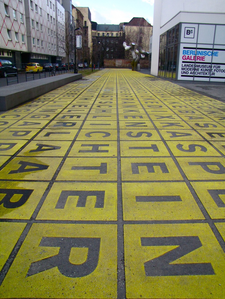 Berlin - Yellow letters on the pavement at Berlinische Galerie