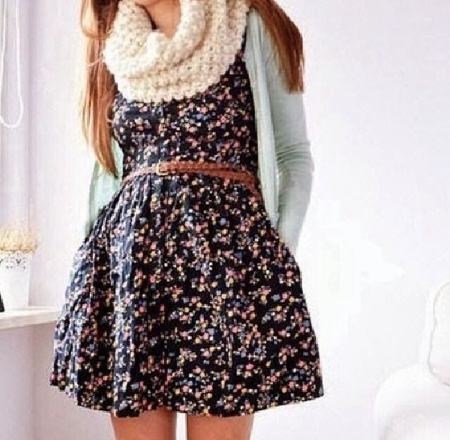 White scarf with white cardigan and floral mini skirt
