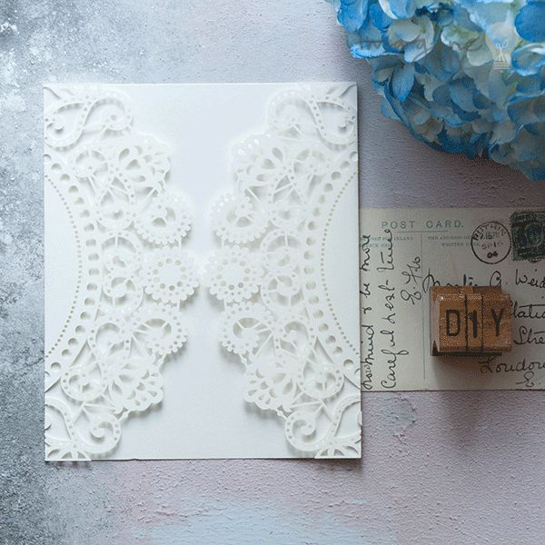 Blank laser cut invitation in white. DIY wedding stationery supplies. Make your own laser cut wedding invitations.