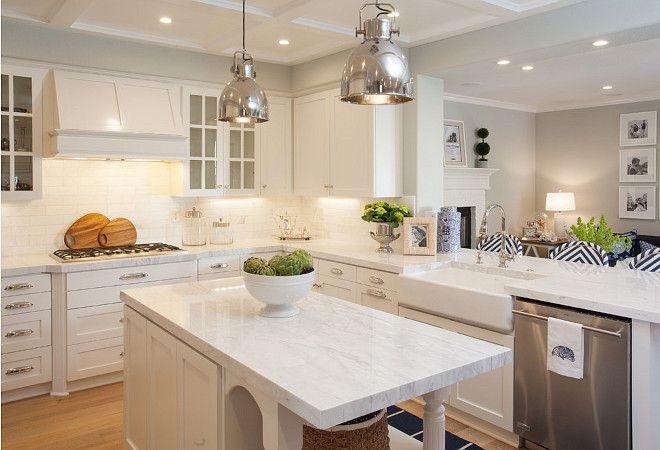 Kitchen Opens to Family Room. Kitchen opens to family room. Kitchen peninsula fitted with a farmhouse sink and dishwasher opens to family room. #Kitchen #FamilyRoom AGK Design Studio.