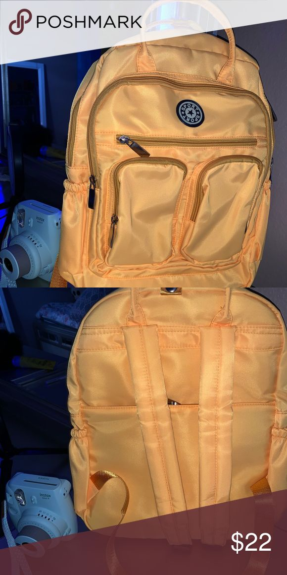 Yellow Multipocket backpack Brand new, never used,…