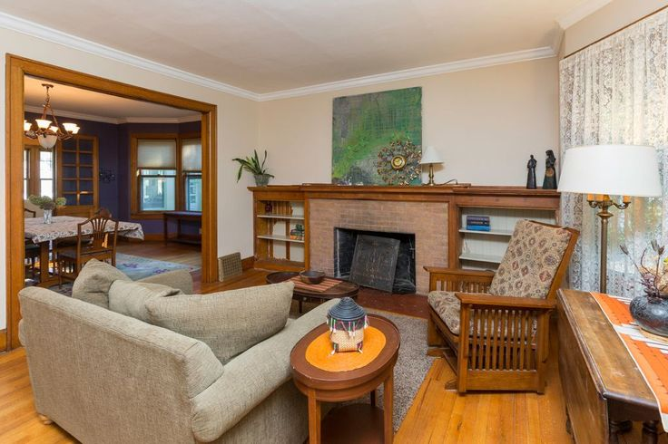 Craftsman Living Room with High ceiling, Amish Mission Glider Chair, Hardwood floors, Built-in bookshelf, Carpet