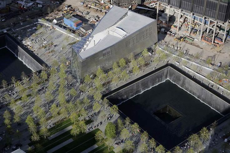 The entrance to the National September 11 Memorial & Museum, center, is located between the two reflecting pools at the World Trade Center in New York.