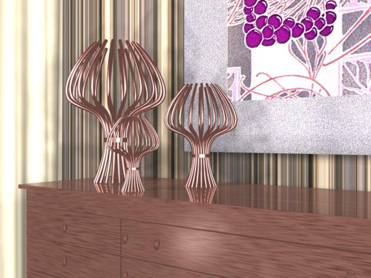 """Segnalazione (categoria studenti): Alberto Panciotti.  Progetto: """"Anemone"""". E' una lampada che nasce dall'unione di più tubi in rame, semplicemente uniti attraverso una fascia centrale."""