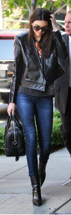 Who made Kendall Jenner's blue skinny jeans, boots, leather jacket and handbag