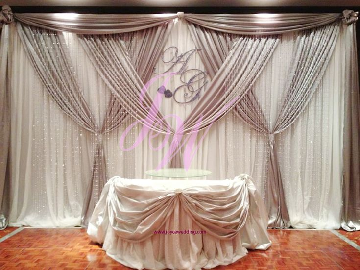 Elegant Silver And White Satin Backdrop At Metropolitan Hotel