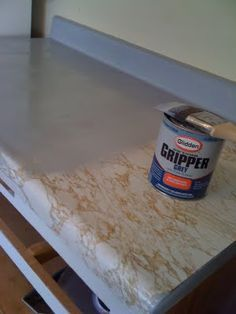 PAINTED COUNTERS – DO SOME RESEARCH IF YOU DON'T WANT TO REPLACE COUNTERTOPS RIGHT AWAY (http://www.hgtv.com/design/rooms/bathrooms/painting-your-countertops-for-a-new-look)