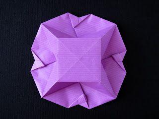 Scatola a fiore - Box Fiore. Origami from one uncut square. Designed and folded by Francesco Guarnieri, March 2008. Diagrams: published on Quadrato Magico 95 (CDO, estate / autunno 2009). Instructions, CP: http://guarnieri-origami.blogspot.it/2013/04/scatola-fiore.html