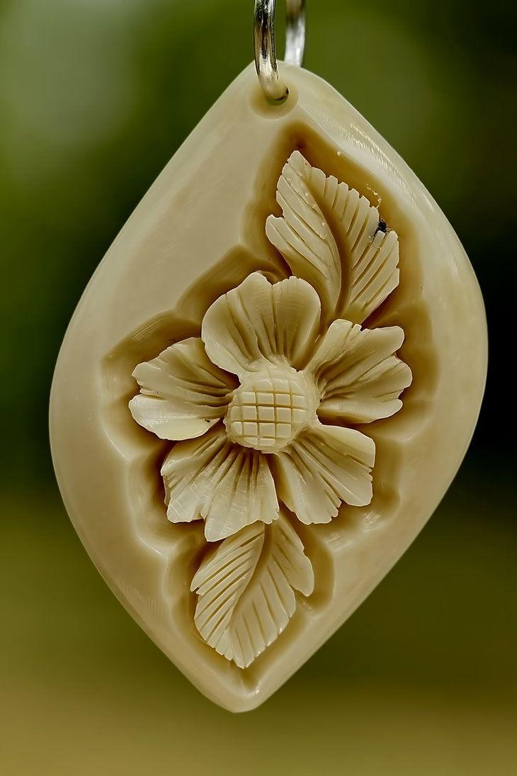pendant 5 - bone carving by manuroartis on DeviantArt