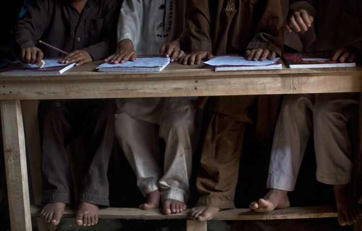 Afghan refugees and Pakistani children, who were displaced with their families from Pakistan's tribal areas due to fighting between the Taliban and the army, attend an exam at their school in a poor neighborhood on the outskirts of Islamabad, #Pakistan. (AP Photo/Muhammed Muheisen)