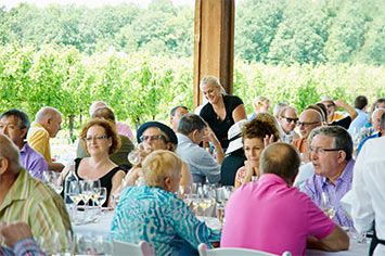 i4c lunches take place in interesting venues including this one on the crush pad at Hidden Bench Vineyards and Winery.