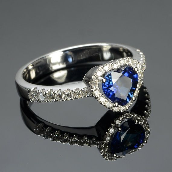 Ring in 18 kt gold with #sapphire of 0,92 ct and natural brilliant-cut white #diamonds of 0,25 ct. The #ring is available in white gold, rose gold, yellow gold but you can also customize carats, quality, and color of #gemstones. All our #jewelry are made in italy. Contact us for any particular request.