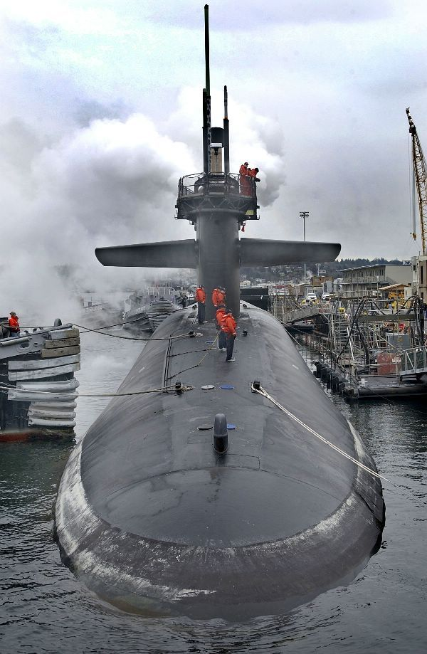 Bremerton, Washington, Feb. 2, 2004: The Ohio class fleet ballistic missile submarine USS Michigan (SSBN 727) enters into the Puget sound naval shipyard and intermediate maintenance facility to commence engineered refueling overhaul and for eventual conversion from a fleet ballistic missile submarine (SSBN) to a guided missile submarine (SSGN). U.S Navy photo.