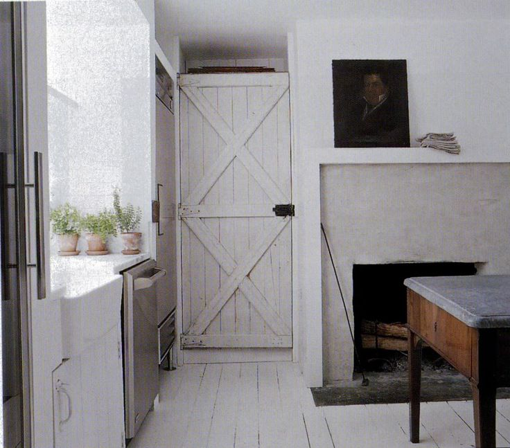 White washed barn door & potted plants
