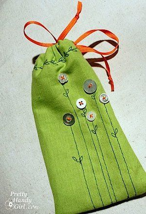 Easy fabric gift bags with a little stitching and adding cute buttons. Cute.