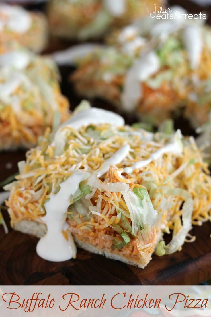 Buffalo Ranch Chicken Pizza ~ Flaky Crescent Rolls Piled with Cream Cheese, Buffalo Chicken, Lettuce, Cheese and Blue Cheese Dressing! ~ https://www.julieseatsandtreats.com