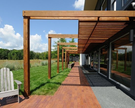 clean edge pergola attached to house and with posts
