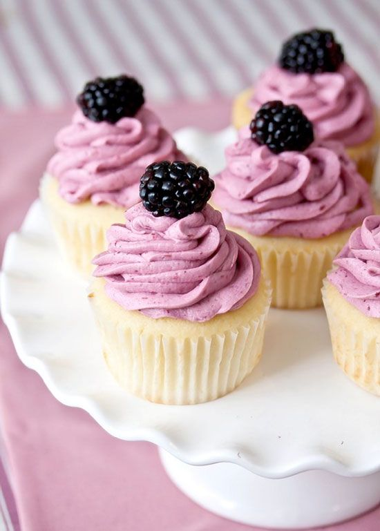 Lemon Cupcakes with Blackberry Buttercream Frosting....that sounds delicious
